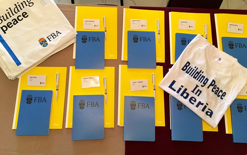 Note books, pens, bag and t-shirt with FBA's logotype.