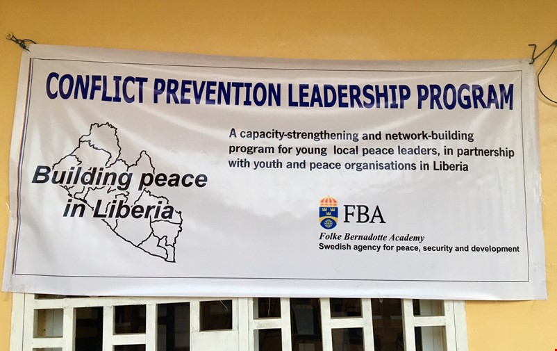 Banner saying Building peace in Liberia.