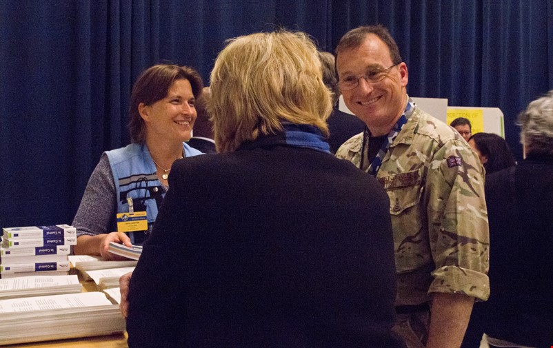 Participants from civilian and military organizations interact.