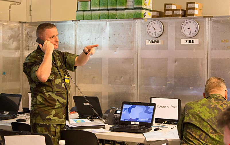 Military personnel having a telephone conversation during the Viking exercise.
