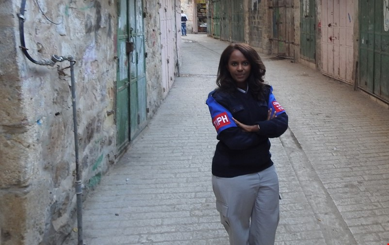 Idil Jamac patrolling the streets of Hebron.